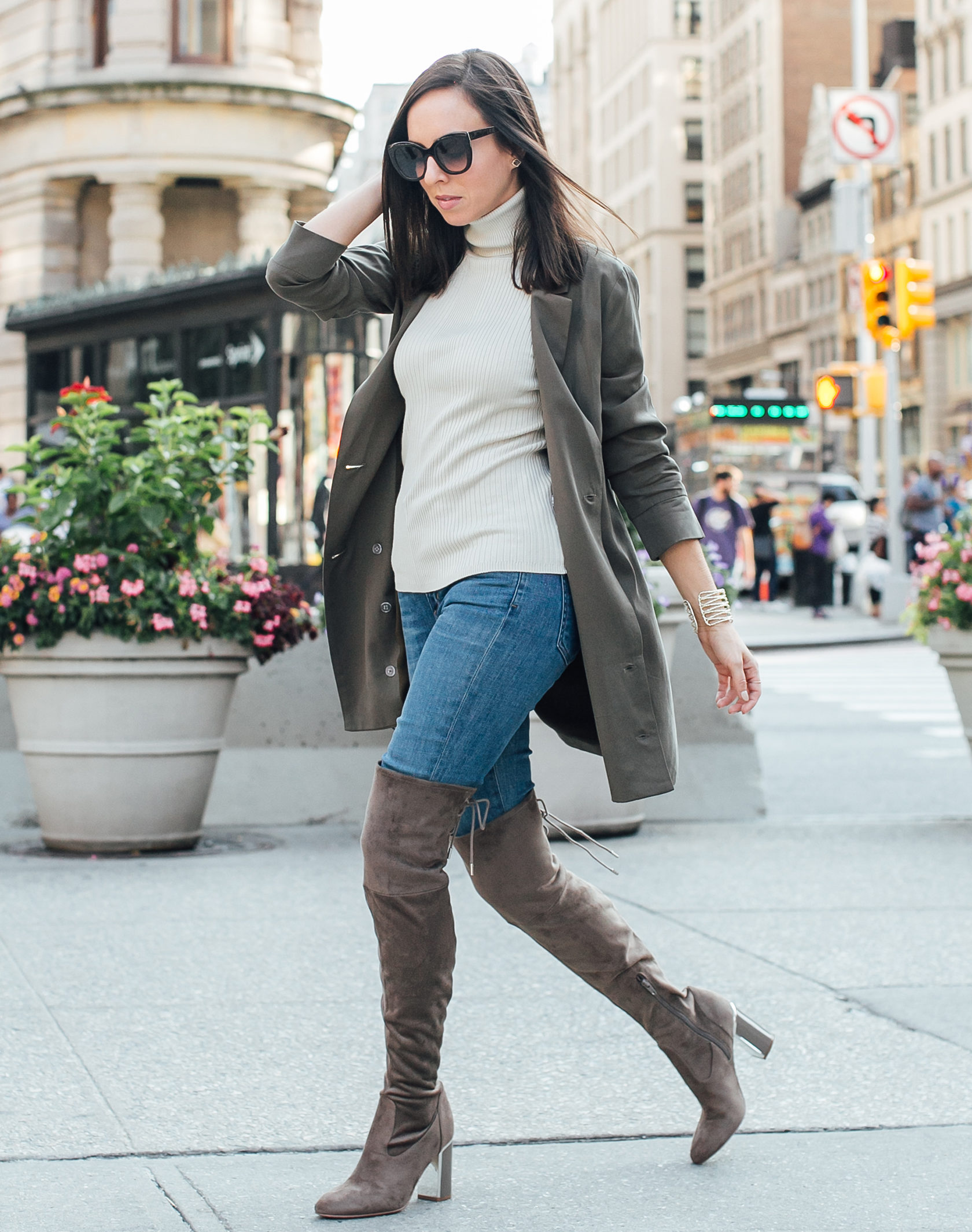 Sydne Style shows how to wear thigh high boots for fall