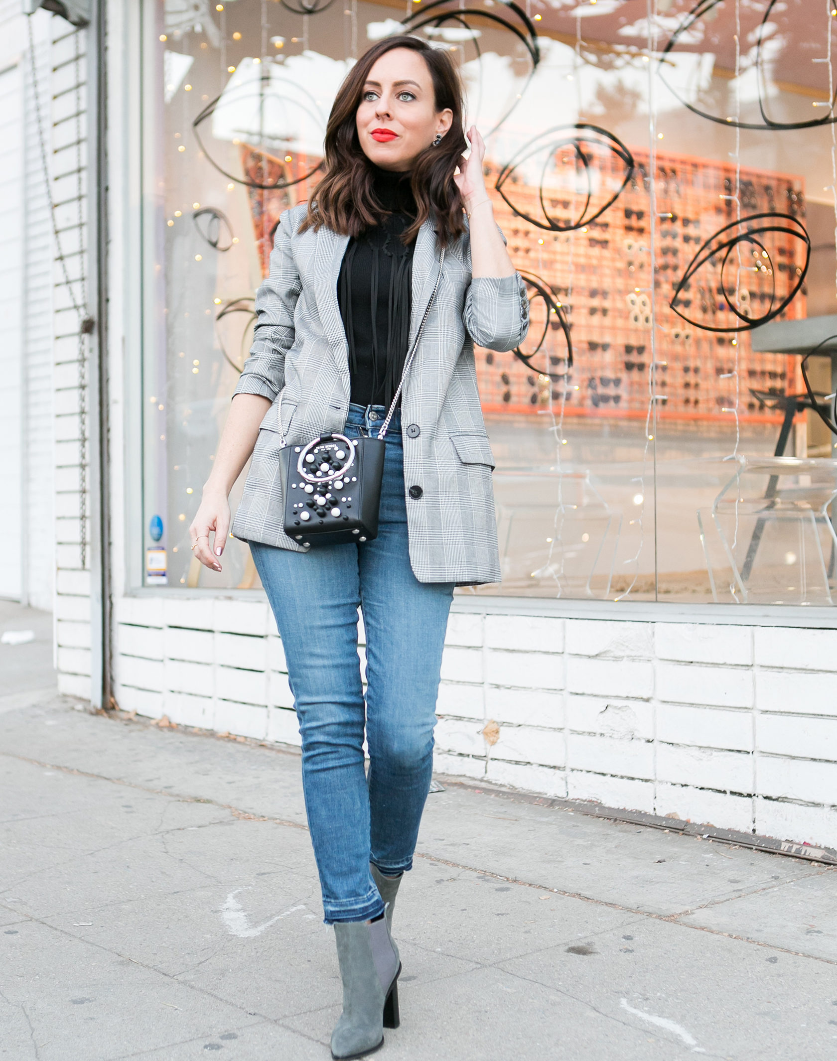 Sydne Style shows how to wear the plaid blazer trend with skinny jeans