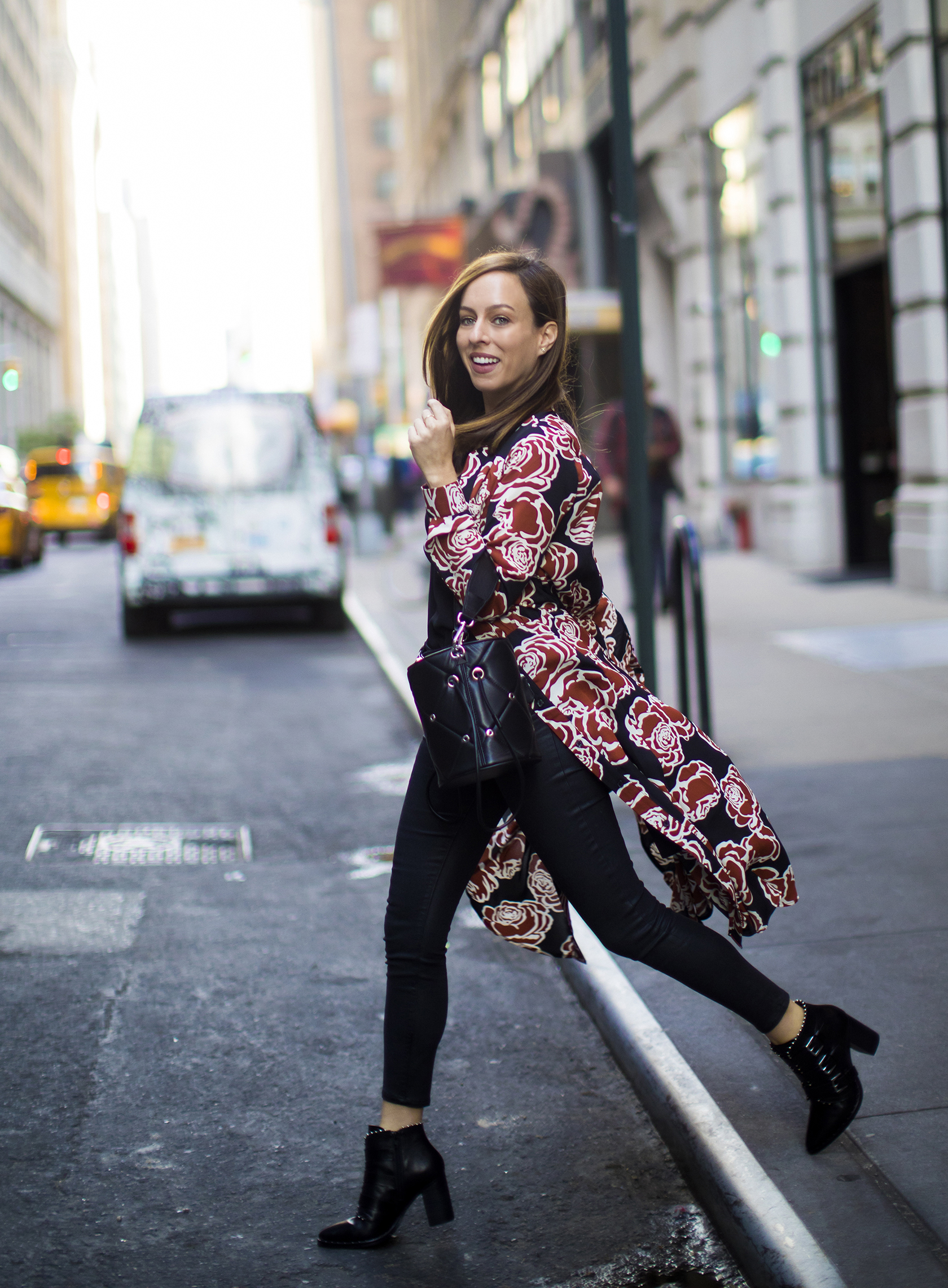 Sydne Style shows fall outfit ideas with floral shirt dress and jeans