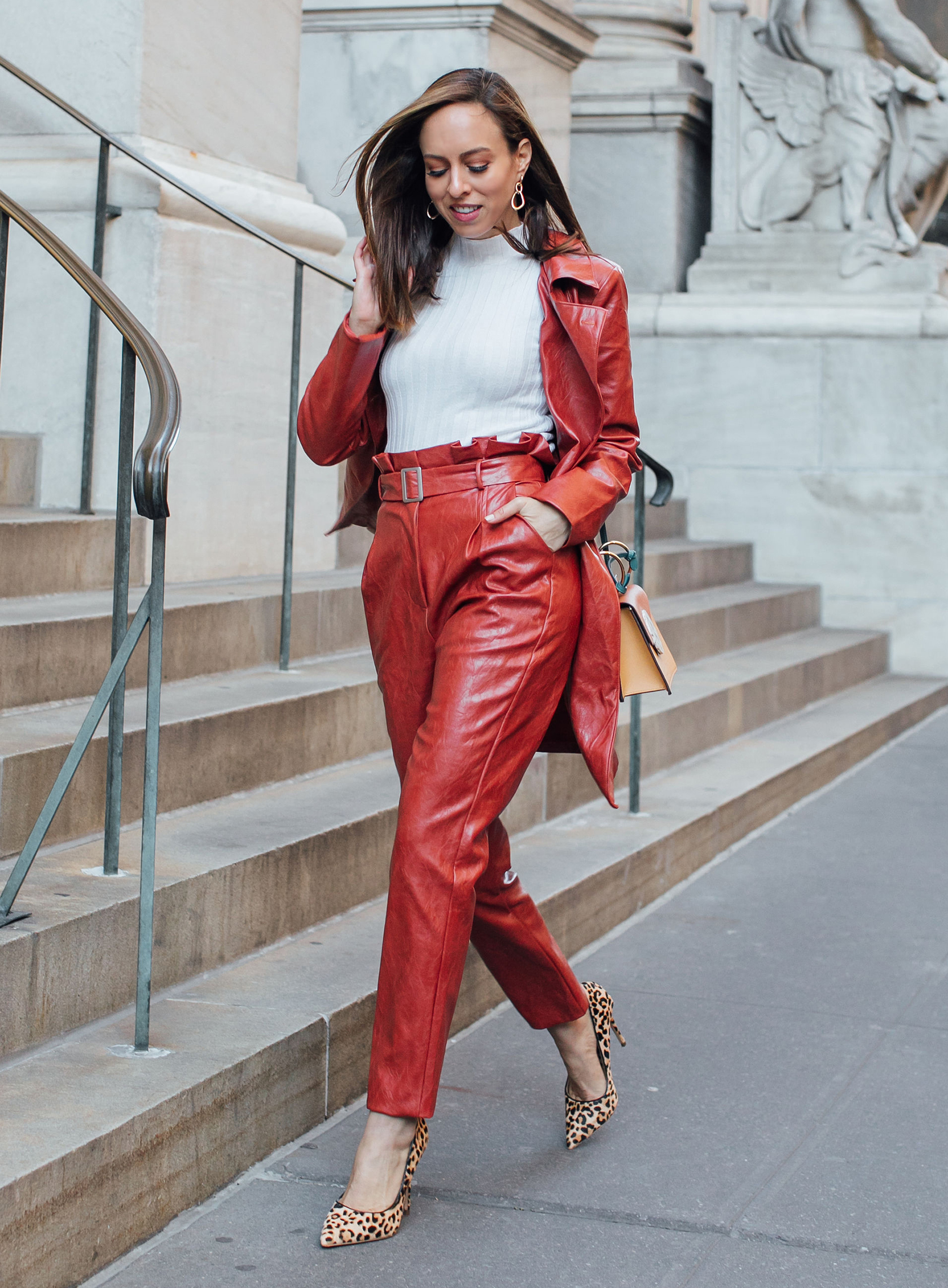 Sydne Style shows how to wear colored leather for fall in majorelle pants and leopard shoes