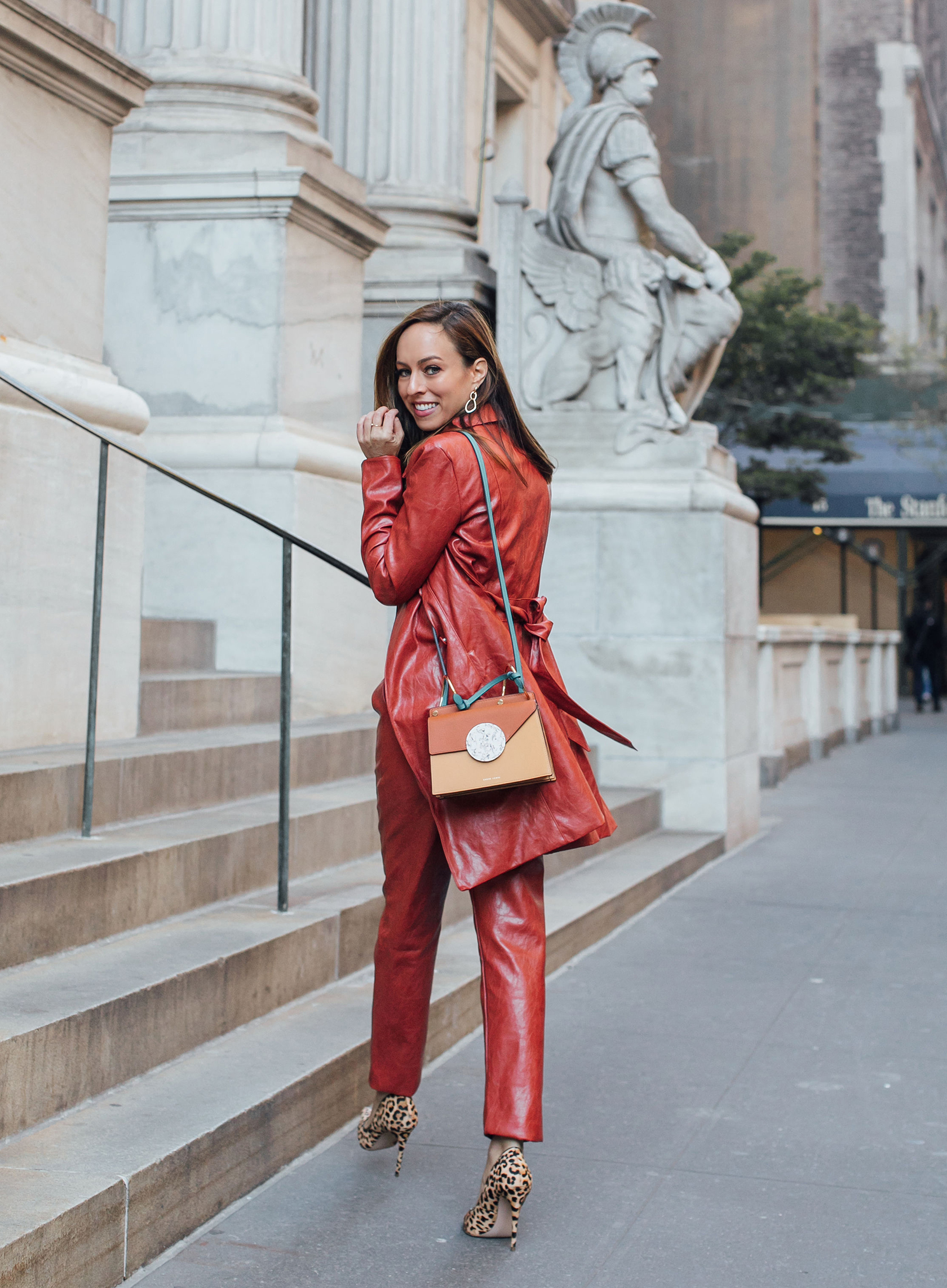 Sydne Style shows leather outfit ideas for fall in majorelle trench coat